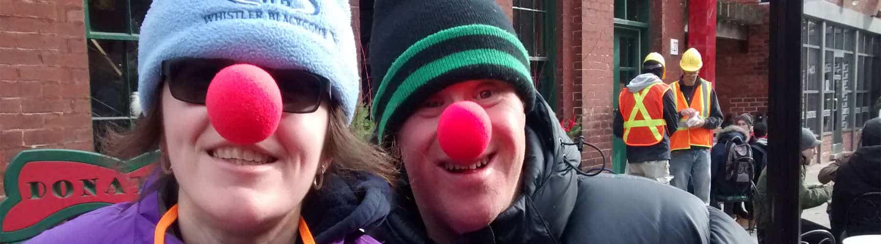 Addus Participants Wearing Red Clown Noses Feature Slider Image Home Page
